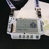 A custom Maker Faire badge, an open source project from wyolum.com.