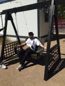 Las Vegas Mini Maker Faire organizer, Paweł Szymczykowski takes a quick break by testing out a swing by Las Vegas Swings.