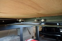 The underside mechanism of the bed slides. It's a very simple but clever spring and pulley design.