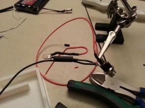 Wiring status LED to DC input.