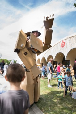 Jason Lentz suits up and prepares to be toppled by an onslaught of kids at the Giant Cardboard Robots exhibit.