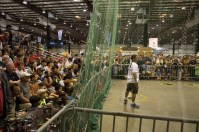 Spectators applaud a multiple-multicopter battle in the Game of Drones in Expo Hall.