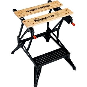 This weekend, I finally got tired of having this guy be my only workspace in the garage. Any time I wanted to use my table saw, or planer, or jointer, or drill press, or router, I had to clear off this table, hoist the tool up there and clamp it in place. Talk about a lot of wasted time.