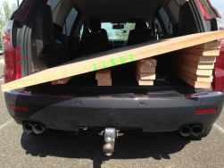 """Home Depot. My SUV can fit a 48"""" wide sheet of plywood perfectly, but I guess MDF is sold in 49"""" widths."""