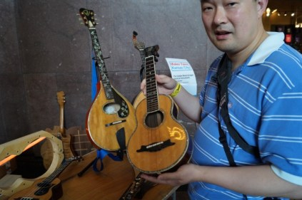 checking out the luthier's work