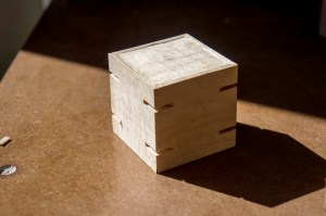 """Polyfractal writes, """"When you glue mitered corners, the bond isn't very strong.  A common way to strengthen it is with splines - little pieces of wood which are inserted into the corners.  Here you can see the grooves which will accept the splines."""""""