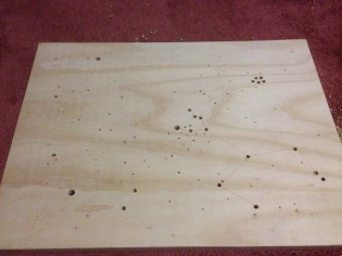 Here all the star holes are drilled out. There was a lot of splintering on the back, so I made sure to sand that off.