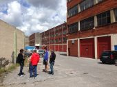 Bilbao Mini Maker Faire team strategizing in front parking lot of the Cookie Factory