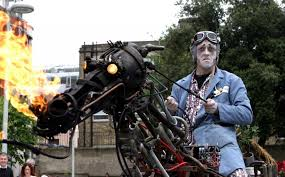 Simon Collins (aka Paka) is an interdisciplinary artist who works with large-scale mechanical sculpture. Paka combines many skills to create interesting characters, and often involves the audience in his work.Rusty the Horse is a remote control kinetic sculpture with a personality all his own. Audience members feel as though they have met a real horse as they see Rusty move, whinny, rear, defecate and even breathe fire. Paka will be riding around on Rusty at the fair.