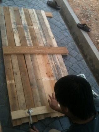 I dismantled the wood pallets and arrange them based on the door measurements. 2 wood pallets seemed enough.