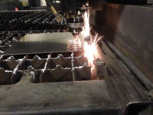 Laser cutting is a cheap and effective way to get complex parts.