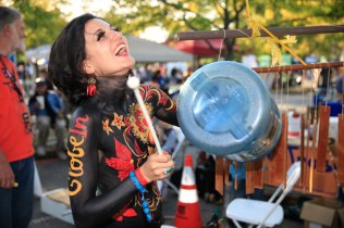 Anastasia Miron, a walk-in maker from crafting company GlobeIn, enjoys a kinetic moment at the Bash the Trash exhibit.
