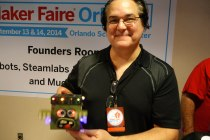 Michael Ingrassia holds an educational robot he designed.