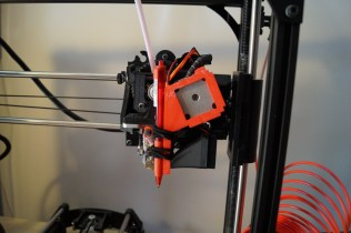 snaps onto the extruder stepper. No modification necessary at all