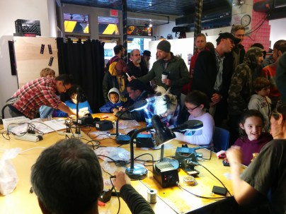 The Learn to Solder booth was full all day with people - of all ages - learning to solder!