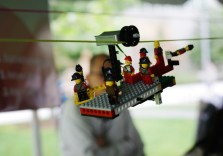 """Lego creations created by kids, floated on a """"Sky Parade"""" tramway built by a few members of the Lifelong Kindergarten Group at the MIT Media Lab. (photo by Erica Tremblay)"""