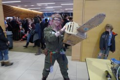 Lindy from Site 3 wields a cardboard chainsaw