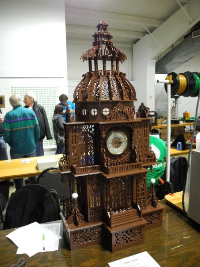 A large 3D printed clock tower on display.