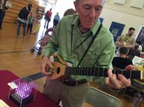 Dentist Victor Chaney demos his backpack guitar. He also makes giant rolling ball sculptures