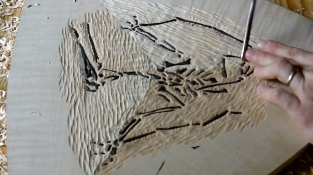 To give it that 'excavated' look Andrew hand carved grooves around the fossil, giving it a more realistic look.