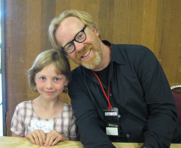 A very young Super Awesome Sylvia with maker icon Adam Savage.