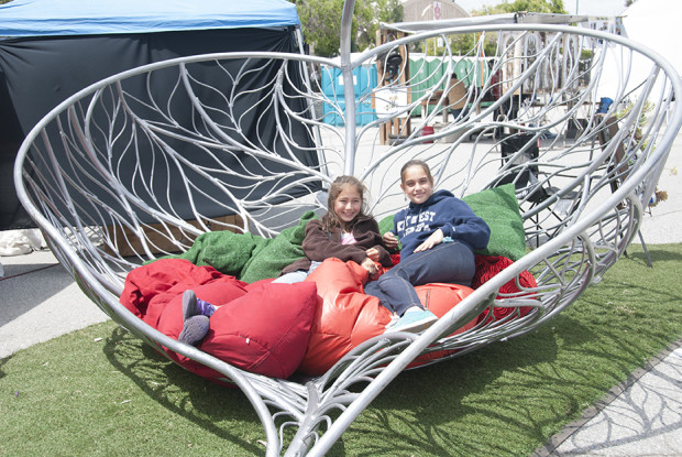 Kickin' it in the Tumble Leaf sculpture by Karen Cusolito.