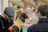 Joey Hudy (Right) talking to Robert Thomas (Left), co-founder of TechShop, about the Boosted Board longboard.