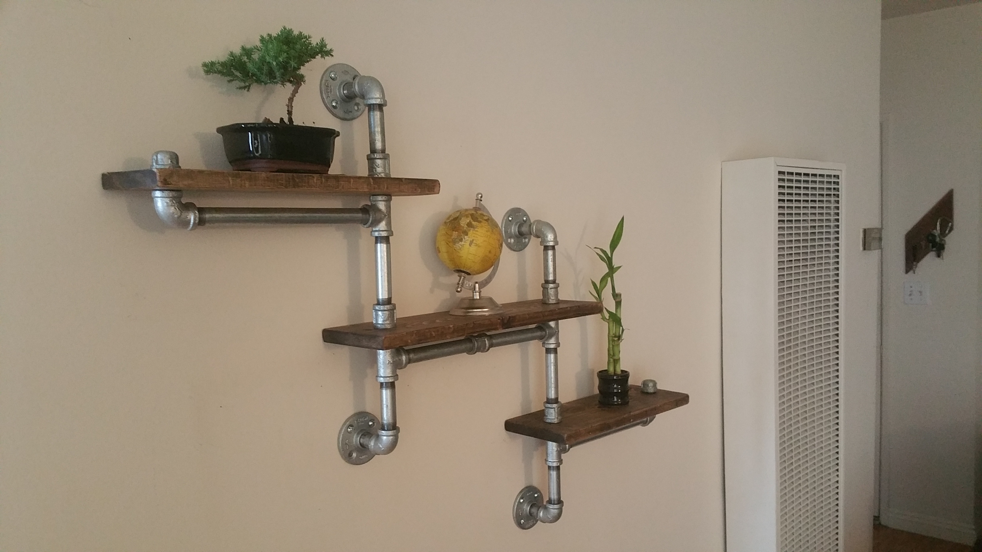 These 6 Pipe Shelf Ideas Are Plumb Cool