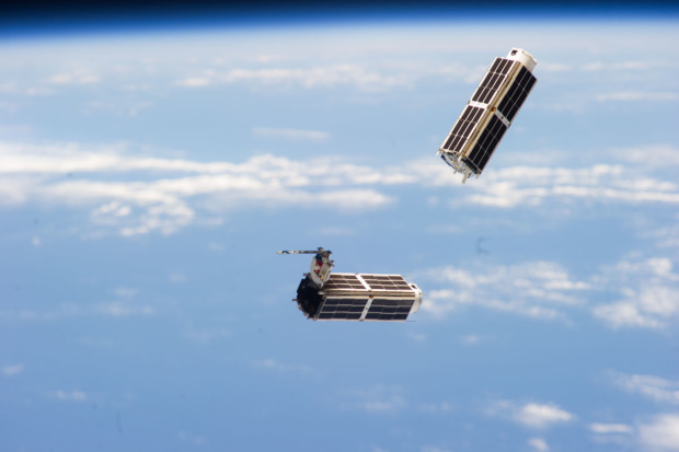 Two Planet Labs 'Doves' from Flock-1 just deployed outside the ISS. (Credit: NASA)