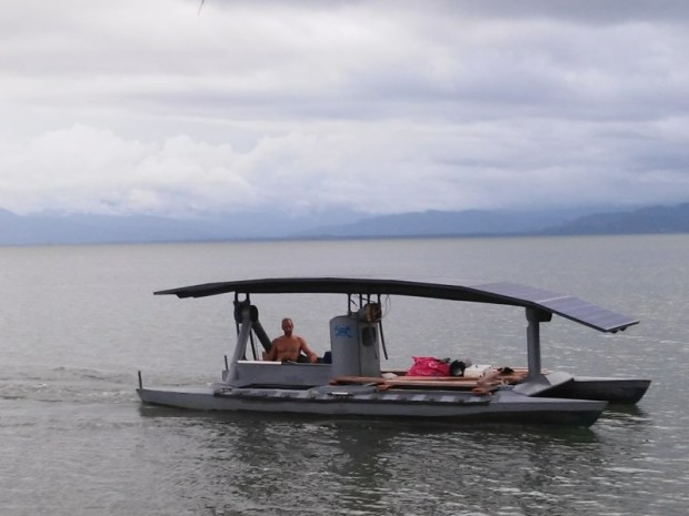 Out for a cruise in his solar powered pontoon boat.