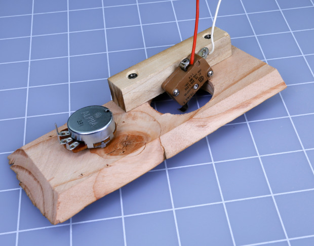 """Figure I. A snap-action switch is mounted on a piece of ½"""" square poplar with #2 screws."""