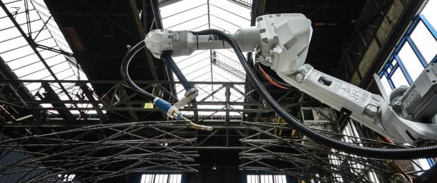 An ABB Arm Prints A Scale Bridge Model