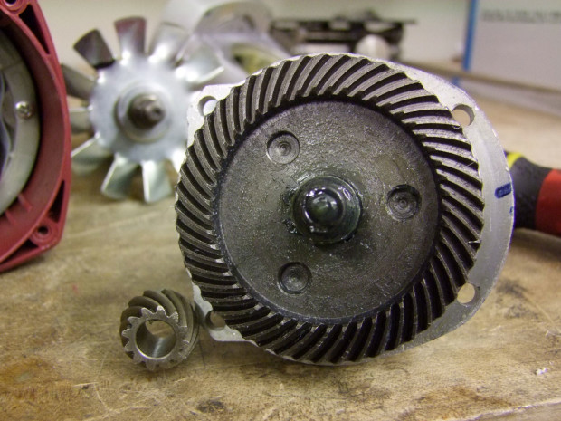 """The insides of an inexpensive imported 9"""" handheld angle grinder's gearbox."""