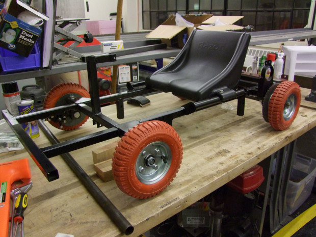 "The frame is welded from 1"" square steel tubing, the wheels were supposed to be for handtrucks, and the brakes were taken from the electric scooter parts bin."