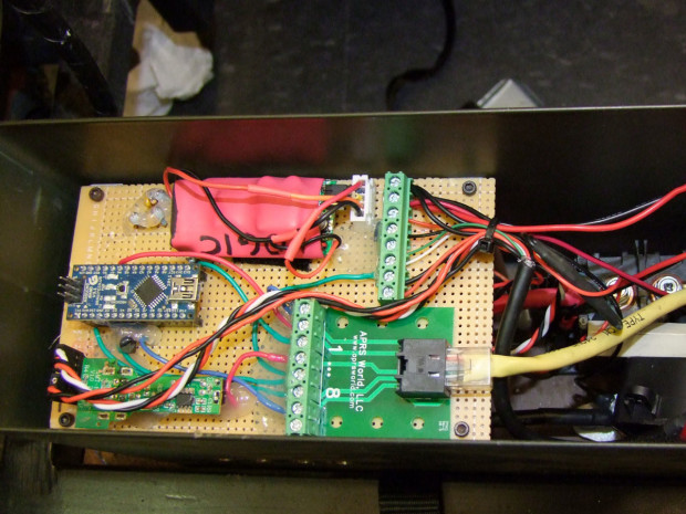 The electrical deck of Chibi-Mikuvan consists of an Arduino Nano, a modified USB charger as a power supply, a high-current relay connected between the battery and motor controller, and a current sensor. The red component is a backup logic power supply.