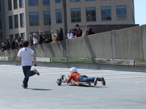 A uniquely shaped student go-kart runs a time-trial race in the 2013 final contest at MIT.