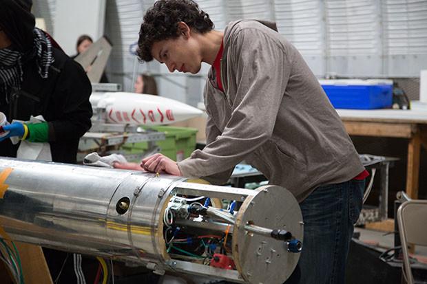 Ryan Callahan preps the rocket at the FAR site. Photo: Hep Svadja