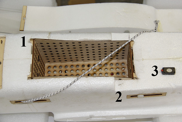 Bottom view of aircraft with payload box and drop mechanism installed