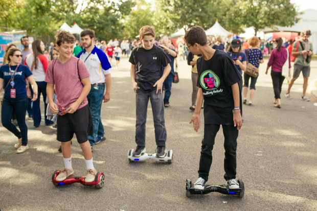 Ahmed met some other kids riding around the Faire on sideways skateboards. (Photo: Hep Svadja)