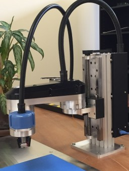 The FLX.ARM precision robotic arm by Flux Integration.