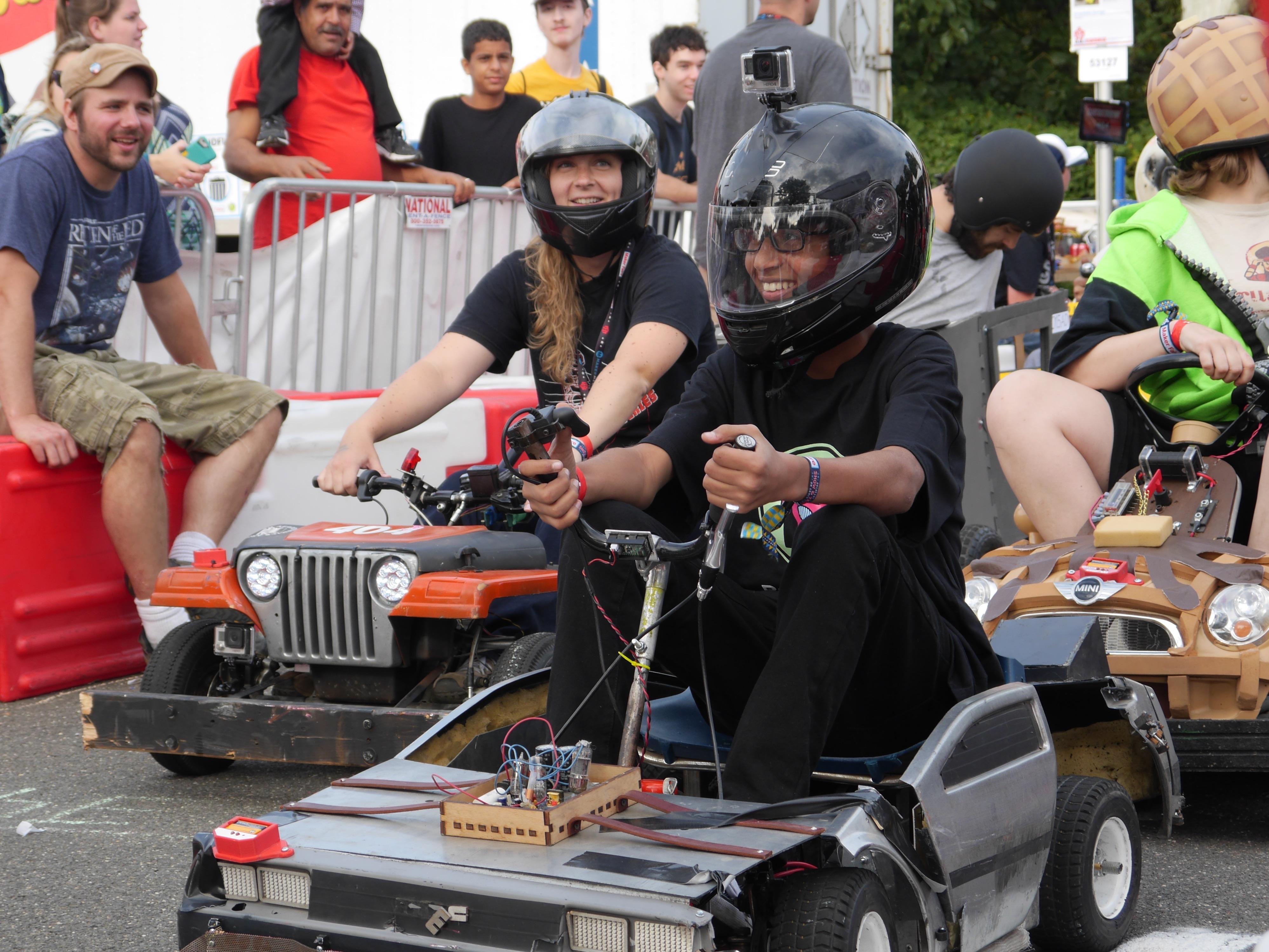 Ahmed Mohamed Races DeLorean Go Kart at World Maker Faire