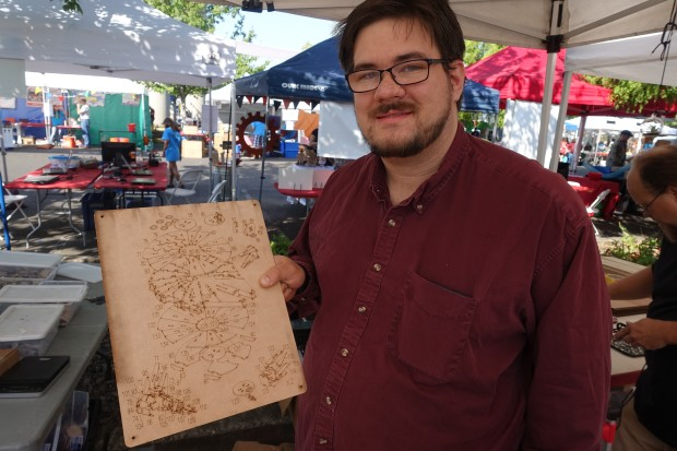 Brent fro C4Labs with one sheet of his wooden cut-out book.
