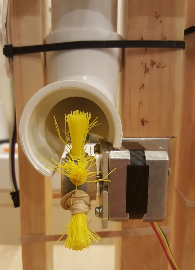 The candy actuator mechanism, made from a plastic brush.
