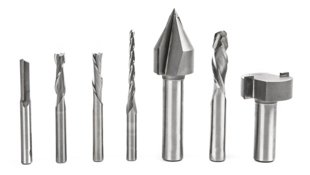 From left to right: straight flute, upcut, downcut, ballnose, V-bit, compression, and table surfacing bits.