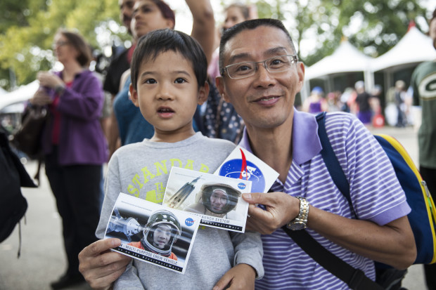 Father and son with NASA photos