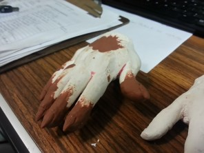 Beginning work on sculpting the hands, paying special attention to the fingertips/nails.