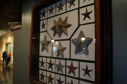 Star brackets for holding cross braces on buildings