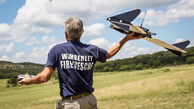 Gene Robinson launches a SAR drone. Photograph by Angelique Robinson