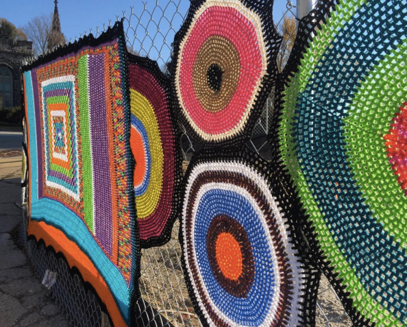 We've been yarn-bombed! This beautiful addition to our construction fence appeared one weekend. (Thanks to Deb Butler and friend!)