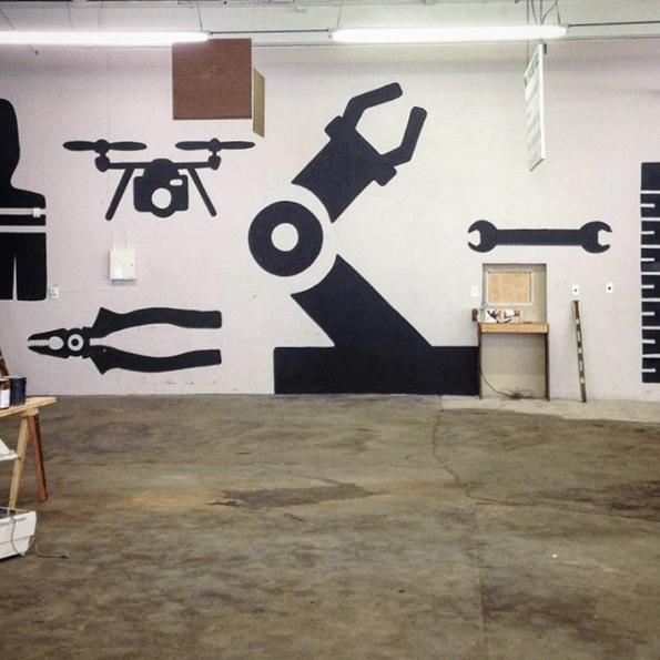 Graphic artist Greg Gannon (@6reg6annon) interprets our graphic designer Jermaine T. Bell's (@jtbeezwax) flier design for our walls. It takes a maker village.